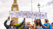 "Westminster, London, United Kingdom - June 25, 2016: Young female students pro-remain protesters carrying poster saying ""You stole our future from us"" as part of protests against Brexit in front of the House of Parliament in London, UK."