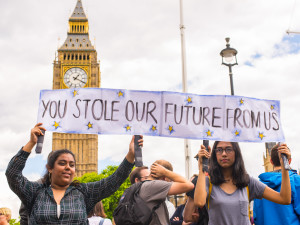 """Westminster, London, United Kingdom - June 25, 2016: Young female students pro-remain protesters carrying poster saying """"You stole our future from us"""" as part of protests against Brexit in front of the House of Parliament in London, UK."""
